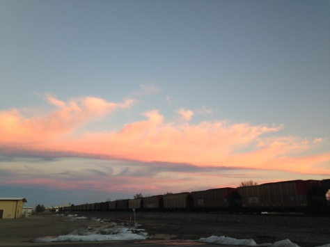 Stopping to wait for a train makes for a good sunset photo op.