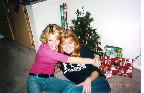 This is from 2004 -- the year we moved into our apartment. Look how young we were (and how awesome my bangs were). Now we're all grown up and she has a baby. Weird.